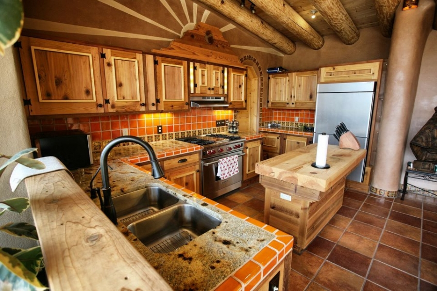 One of the great things about earthship homes is that each one is totally unique. What are your thoughts on this earthship home's kitchen?