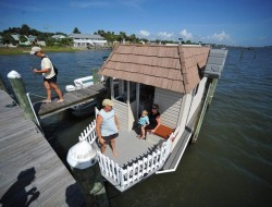 Handmade Houseboat Takes to the Water In by Wayne Bachman - Indian River Lagoon in Sebastian