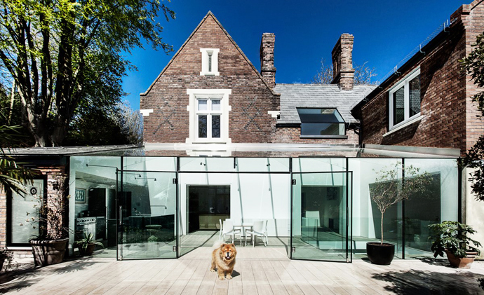 Traditional Brick House With Modern Glass Extension