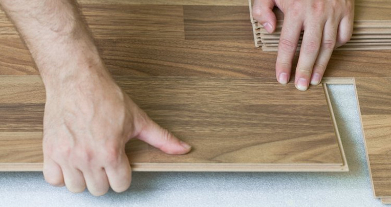 Narrow board laminate flooring showing a typical 'click' connection.