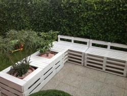 Here's another great way to repurpose the humble pallet.  I particularly like the planters.