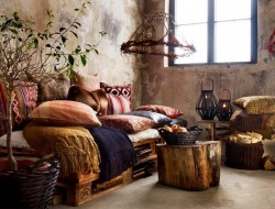 Pallet sofa and tree stumps for tables.   It might be rustic, but I like it.