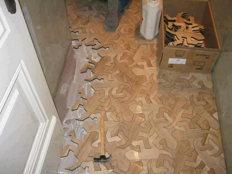 I always worry when I have to rely on a translation, but I think this Escher inspired floor was created by