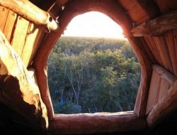 Is a window technically a window if it doesn't have any glazing?  I don't know, but I love the natural feel of this