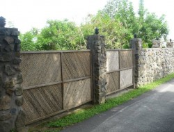 "So often when people try to blend different styles it ends up looking ""wrong"".  Personally, I don't think this is the case here with this huge stone wall combined with bamboo gates.  What do you think of it? Have they got it right?"