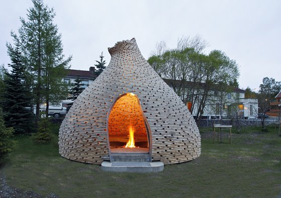 This 5.2 x 4.5 metre beauty is fashioned after traditional Norwegian turf huts and old log construction. The structure is made of 80-layered circles of framing offcuts.