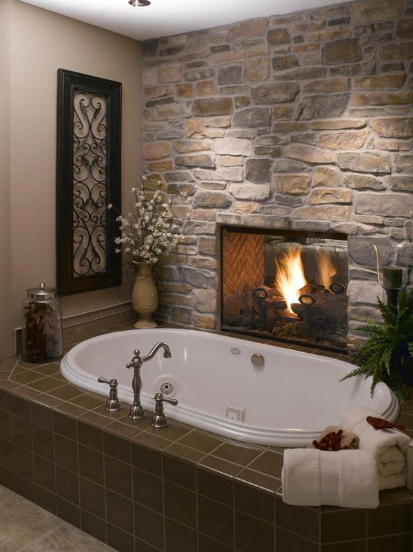 We previously featured a bathroom with a fireplace. Would this be great on cold night or what???