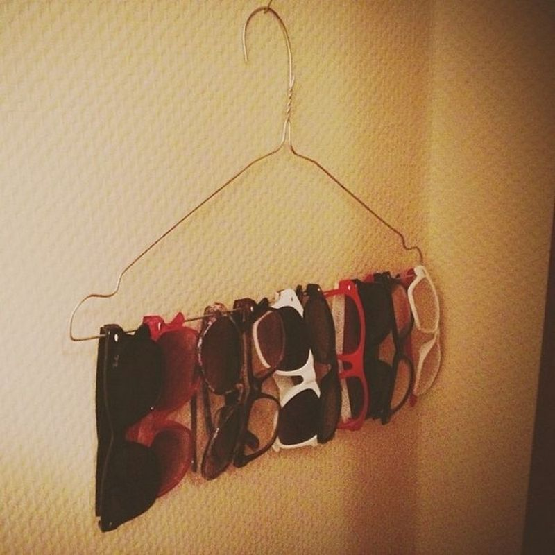 Use a wire hanger to store your sunglasses.