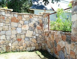 Privacy Wall with Stone and Steel - DIRTCO Construction
