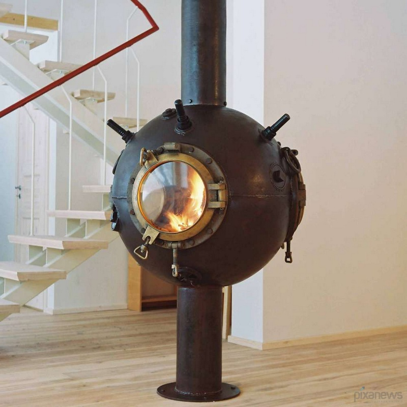 Made from a repurposed WWII mine found in Russia, this fireplace is certainly unique.  What do you think of it?