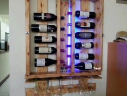 A little while ago we showed you a repurposed pallet wine rack that stored the wine vertically, with the glasses underneath.  Lots of people commented that wine should be stored horizontally. Your wish is our command!
