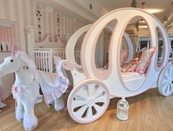On the one hand it's an extreme extravagance sitting at the bleeding edge of consumerism. On the other, how long is a child a child? Do you have a princess in your life who would love this bed? How long before she wants a Barbie Bed instead?