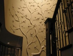 How's this for a unique feature wall.  It is simply made from tree branches attached to the wall and painted.