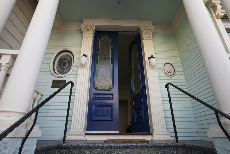 A deep blue front door creates an inviting entrance.