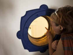 The porthole is a large brass real porthole from a ship!