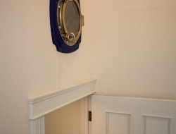 The porthole looks out over the entry stairs, making some interesting wall art as well.