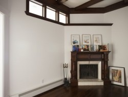 The original beams in the ceiling and the original fireplace have such beautiful rich wood, painting the walls around them a bright white accentuates their deep colors.