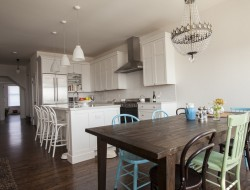 The large open kitchen and dining areas are bright and airy with their high ceiling and natural light.