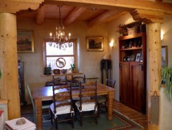 H and H Straw Bale Home - Dining area with Spruce ceiling and tongue and groove ceiling