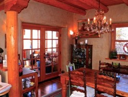 H and H Straw Bale Home - dining area with french doors to screened porch