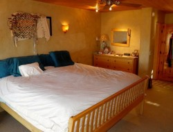 H and H Straw Bale Home - master bedroom
