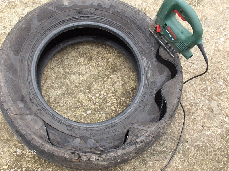 Diy tire planter the owner builder network for What can you make out of old tires