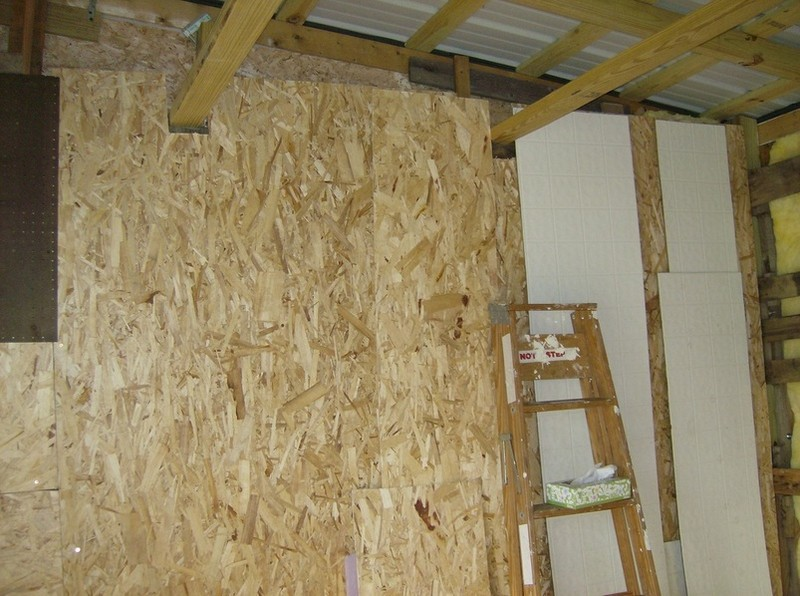 How To Build A DIY Pallet Shed - Adding the floor linoleum