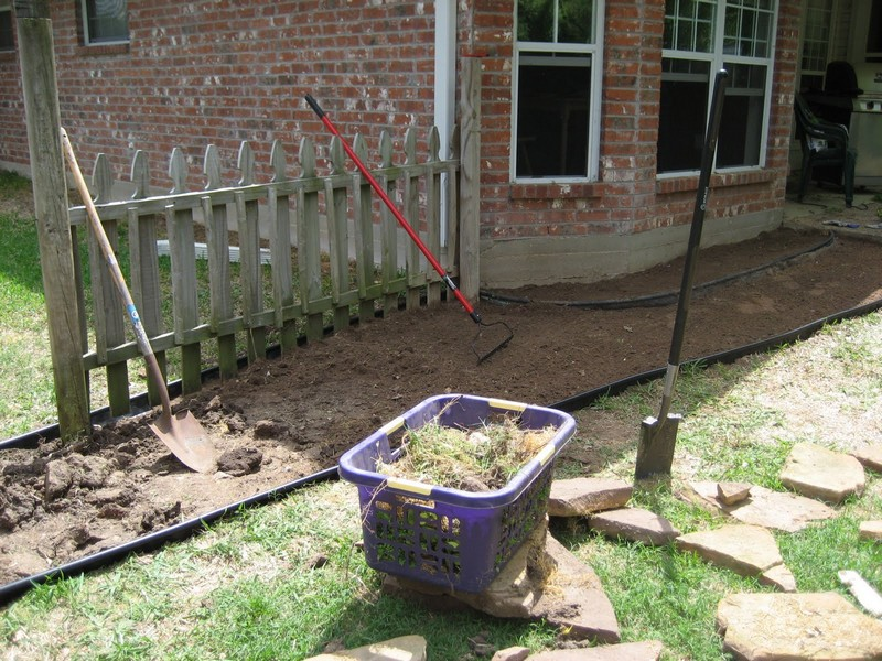DIY Backyard Walkway - Started by moving all the rocks out