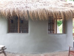 DIY Earthbag Round House - Cement Plaster on Exterior Walls