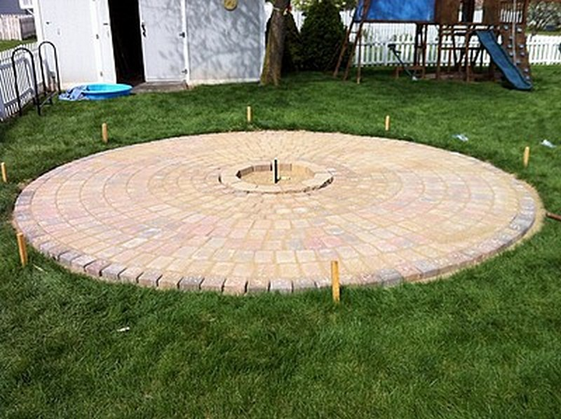 DIY Patio with Fire Pit - Brushing Pavers