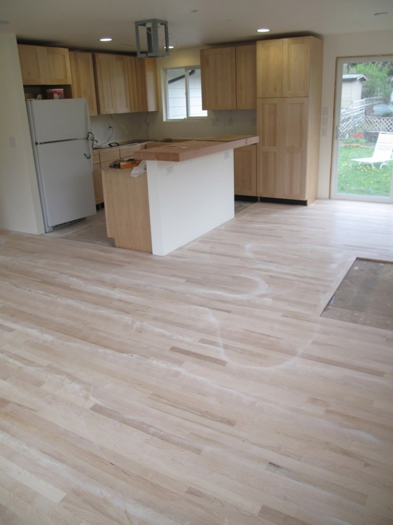 DIY Reclaimed Wood Flooring - Sanded and sealer coating