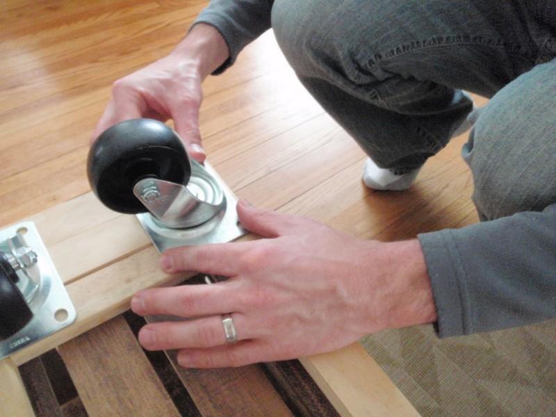 DIY Vintage Crate Shelving Unit - Attach the casters