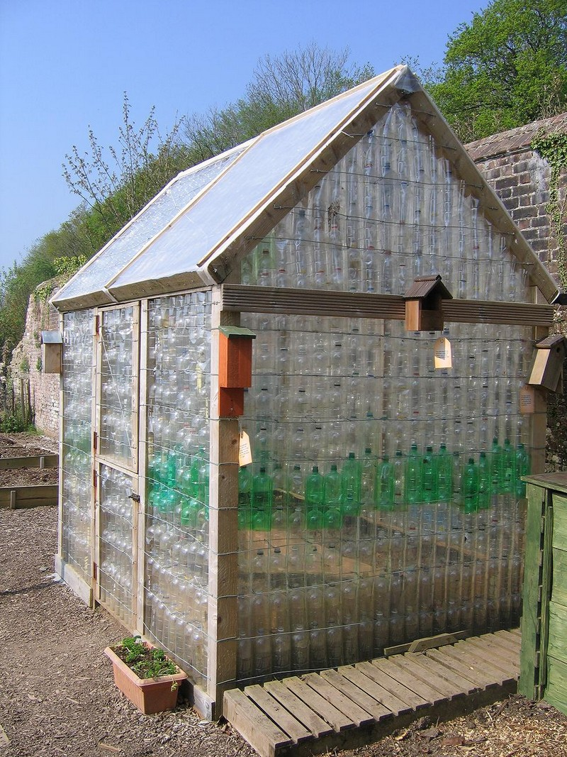 Repurposed plastic bottle greenhouses the owner builder for What is a greenhouse made out of