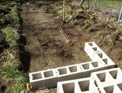 DIY Cinder Block Raised Garden Bed - Lay the block