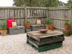 Small courtyard area with pallet furniture.