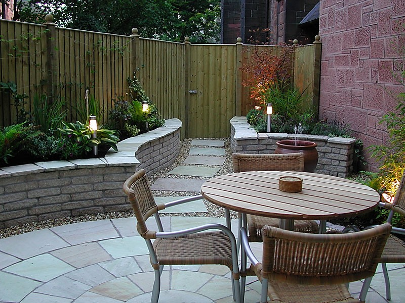 Stone paved courtyard with garden path.