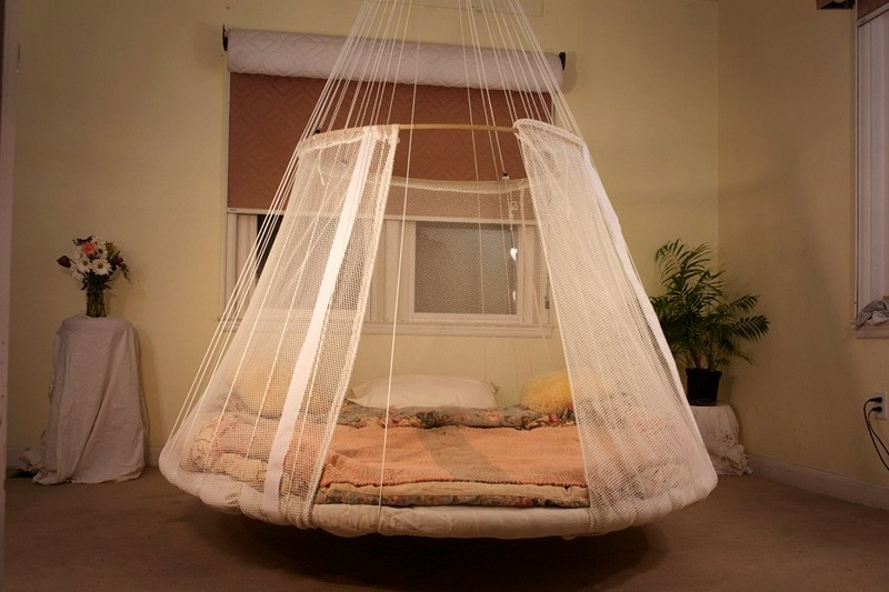 Swing bed made from recycled trampoline the owner for Round hanging daybed