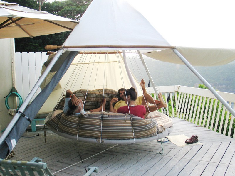 Swing bed made from recycled trampoline the owner for Round hanging porch bed