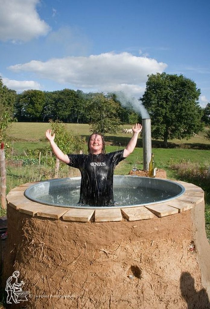 Sizzling outdoor hot tubs that will make you want to for Outdoor bathtub wood fired