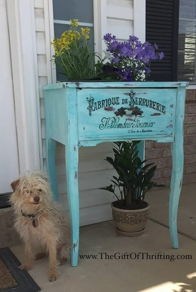 Old sewing table turned colour popping planter