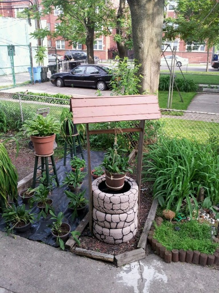 Wishing well planter made from recycled tires the owner - Decoracion jardin ikea ...