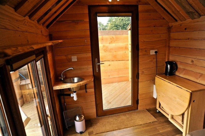 House on Wheels Built-in Hot Tub by Tiny Wood Homes