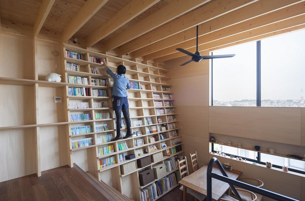 The bookshelf spans both levels of the house.