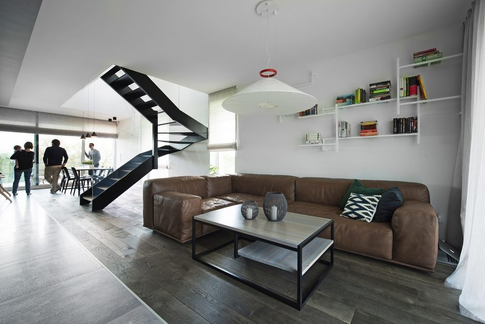 Modern interiors contrast with the old-world charm of the home's exteriors.