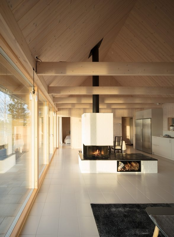 A single fireplace is the focal point of Hus Nilsson.