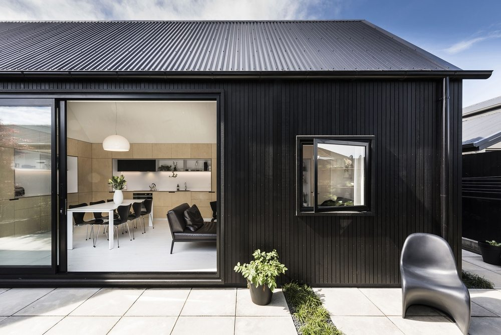 Urban Cottage has a black, sleek, and modern-looking façade.