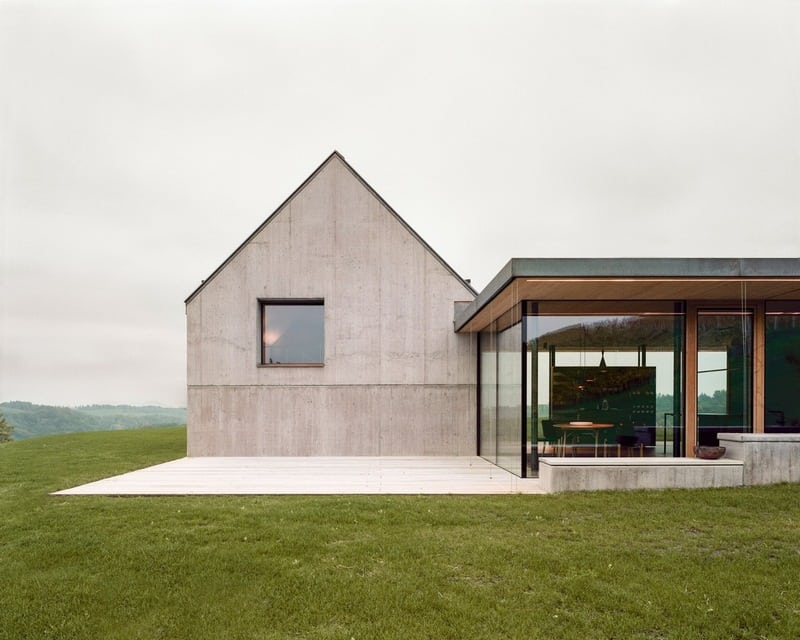 Sitting near a vineyard, House T is surrounded by a stunning landscape.