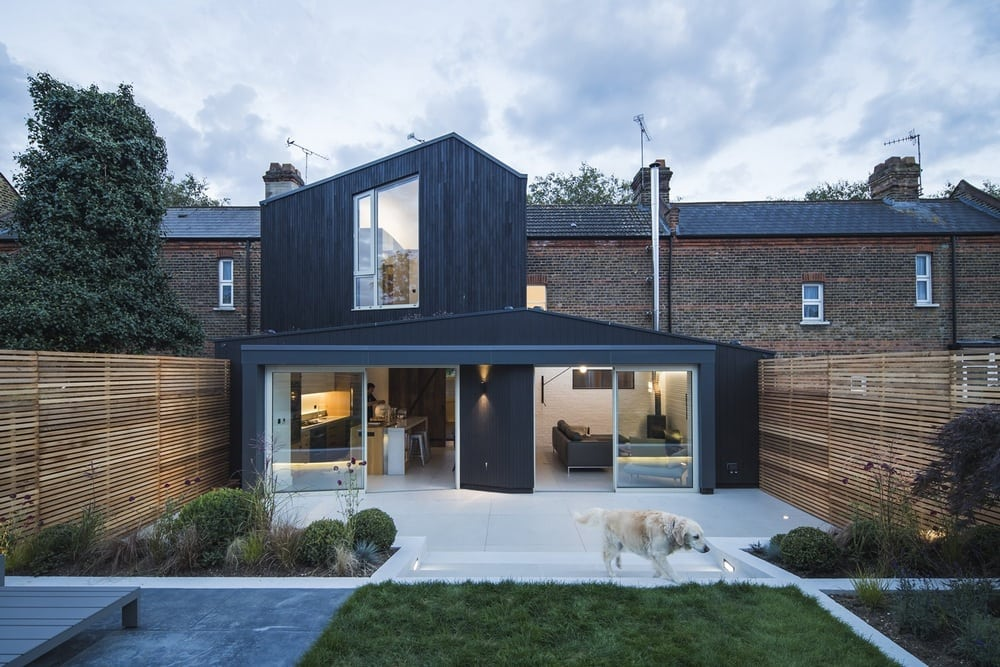 Blackened timber contrasts with the Victorian brickwork of the existing structure.