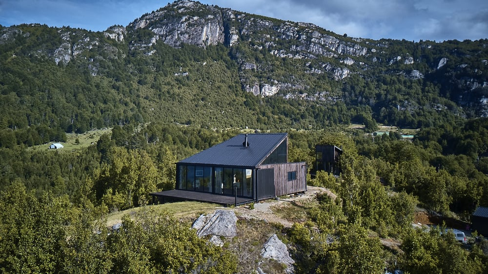 GZ1 House is framed by gorgeous views of the surrounding mountain and lake.