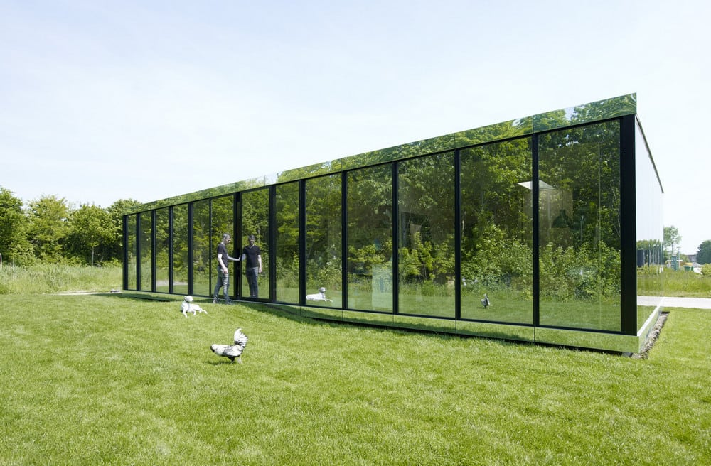 The Mirror House looks invisible as it reflects the surrounding landscape.